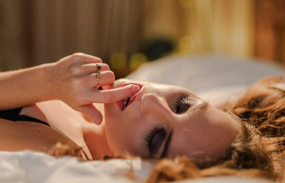 Finger Touching Red Lips