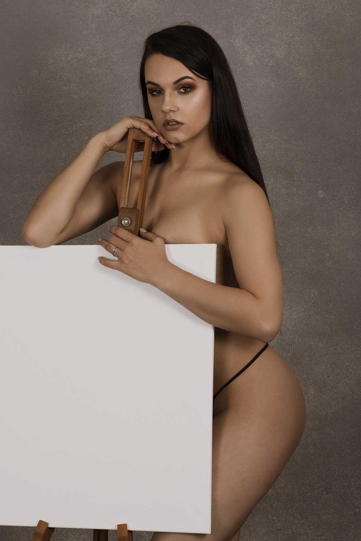 Woman Posing Behind Poster